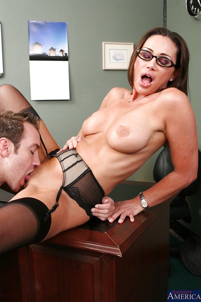 Immense busted office MILF in glasses and  attains penetrated tough on her desk