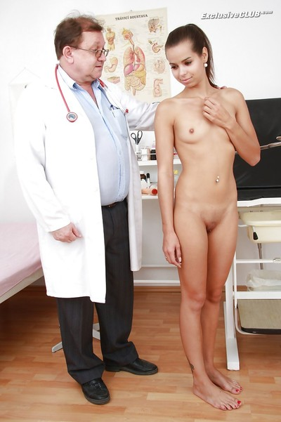Shy dark brown marsh mellow attains her pink twat properly examed by a raunchy doctor