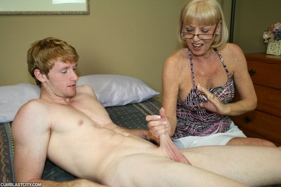 Older scarlet prostate milking youthful rod for massive load of cock cream