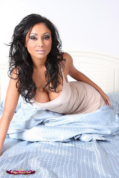 Elegant Indian Pornstar, Priya Anjali Rai, looks appealing lounging around daybed and getting naked!