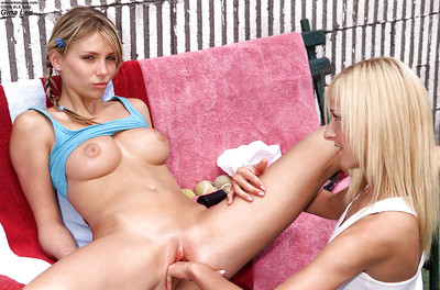 Breasty young female-on-female purchases her cum-hole fingered by her partner