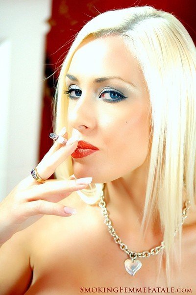 Michelle monroe lets u witness her milk cans even as this girl smokes