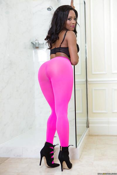 Tattooed brown dime Kiki Minaj slithers spandex panties over colossal anus in washroom