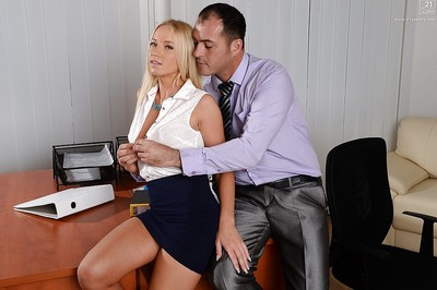 Golden-haired secretary Kiara Lord creeps ball cream from jaw later on hardcore office fucking