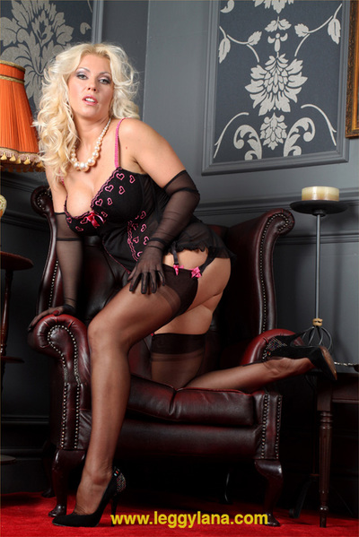 Appealing blond Lana presses her bawdy cleft with a glass sex toy