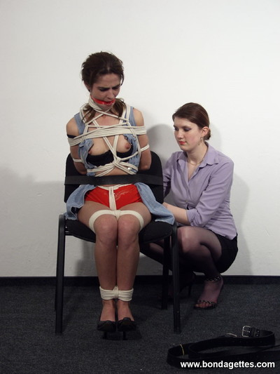 Female-dominant spanks and binds her subbie with rope and leather string
