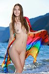 Adolescent girl Izabel A sporting worthy camel toe outdoors on beach in bikini