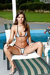 Foxy dark hair in bikini erotic dance and toying her wet crack by the pool