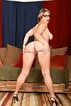 Bosomy MILF in glasses Velicity Von erotic dance off her suit and strings