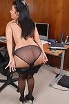 Shocking secretary Holly Taylor is playing with her trimmed puss