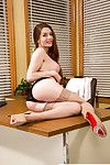Bawdy huge waste chicito Veronica Vain posing in her office in