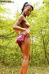 Nude princess with nifty fanny slipping on her underwear outdoor