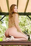 Redheaded centerfold cutie reveals wonderful tiny scones and smooth head love-cage outdoors