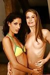 Female-on-female Leanna Charming in bikini handballing her captivating girlfriend