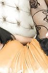 Elegant breasty Oriental transsexual Jame showing off her huge mangos