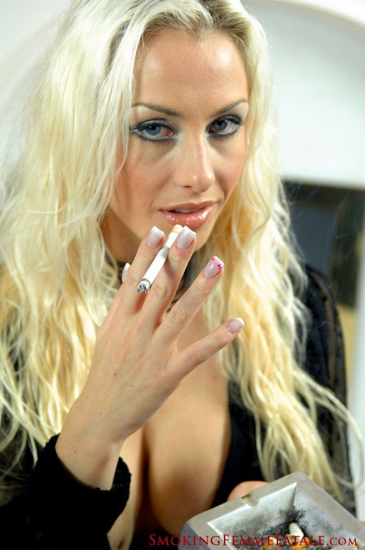 image Erica smokes a cigarette and jerk off a boy