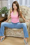 Foxy young in blue jeans erotic dance down and exposing her skinhead pussy