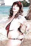 Plump pretty with wild tattoos Dors Feline posing in bikini on the beach