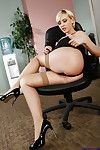 Steamy blond vixen in stockings revealing her goods at her workplace