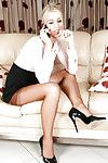 Svelte blondie in glasses and nylons undressing during talking by the phone