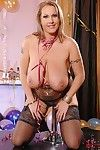 Massive adult broad Laura Orsolya unveiling severe hooters in nylons