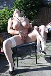 Excited seasoned lady undresses in her garden