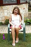 Young milf Model Snow is swelling her fancy legs at the backyard