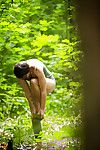 Peeping tom snaps of unclothed dark hair bombita in glasses getting covered in woods