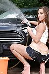 Deviant dark brown lass Amirah Adara washing a car fucking sensually