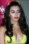 Charli xcx rounded showing boob edge pokies in yellow bikini