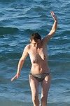 Marion cotillard swimming topless at the beach