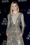 Elle fanning braless in a observe throughout lace costume