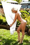 Seductive blond coed Brandi Lynn posing just dressed outdoor