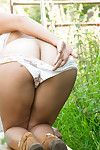 Unshaved booty lass undressed outdoor