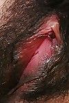 Japanese bombita undressing and exposing her damp shaggy slit in close up