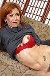Lusty redhead full-grown model undressing and toying her bushy gash