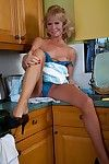 Tattooed aged Cathy Oakley flashing her underclothing in kitchen