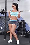 Curvaceous brown hair Bella Reese erotic dancing off her sport outfit in the gym