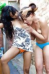 Indian girl-on-girl Kiki tongue giving a kiss white girlfriend Lou-Ellyn outdoors