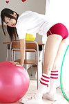 Nagisa Matsayama in sports apparatus plays with massive red hairy mat-bag