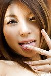 Captivating oriental cutie Azumi Harusaki listlessly erotic dancing off her clothing