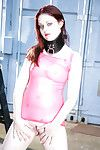 Perverted redhead amateur girl in latex dominant and ebony boots posing outdoor