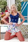Glamorous blond chicito Gigi Allens posing in funky  and short skirt