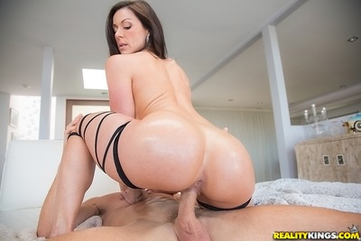 Sexy cowgirl Kendra Lust is ridding a large dagger of her handsome man