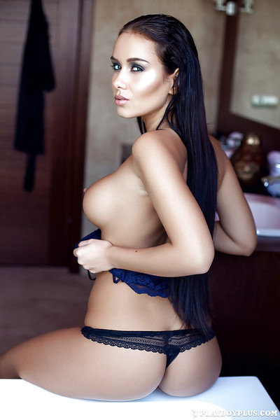 Busty centerfold babe Vivien getting undressed and taking a bath