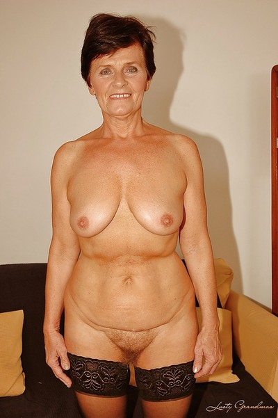 Short haired granny in stockings stripping off her dress and sexy pants