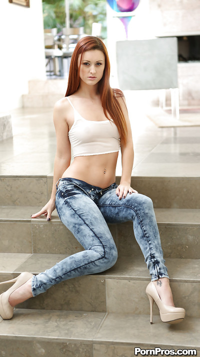 Slippy redhead babe Karlie Montana gains rid of her clothes