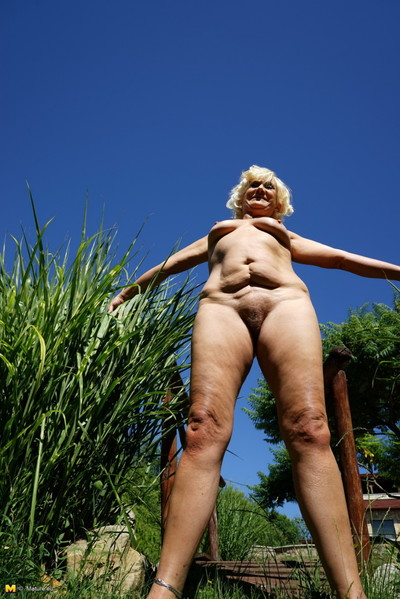 Ache fairy-haired mellow woman getting naughty in her garden