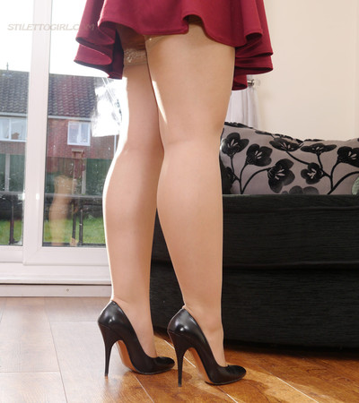 Dark hair in shiny nylons and gorgeous black stilettos