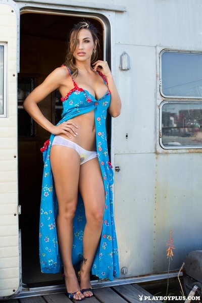 Rounded fit latina posing in her camper